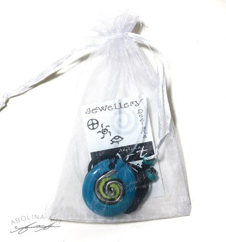 Pendant delivered in bag with symbol meaning on card