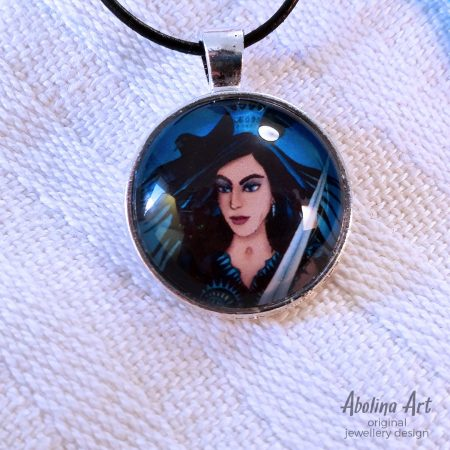 Queen of Swords art pendant 25mm glass dome strung on black cord
