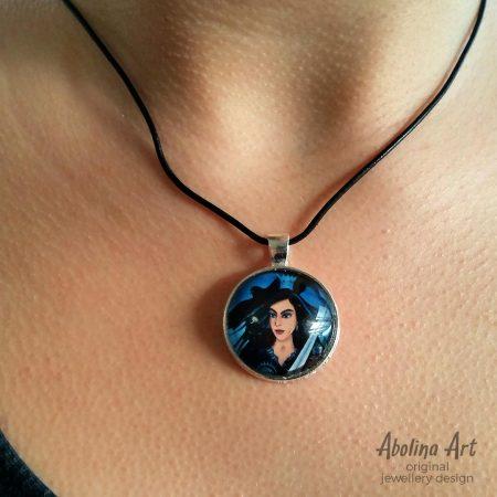 Queen of Swords art pendant worn by model