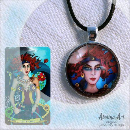 Chariot pendant displayed with tarot artwork