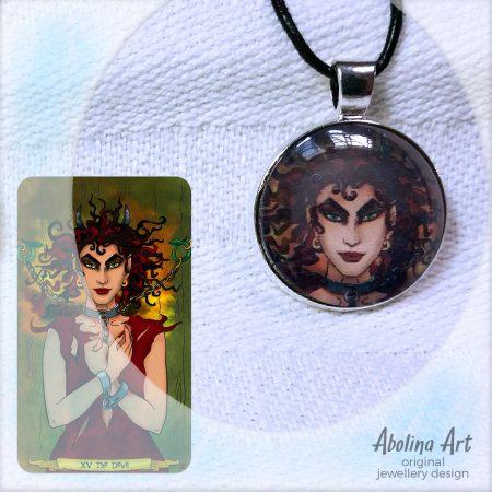 Devilish art pendant displayed with tarot art reference