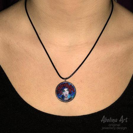 Chariot art pendant worn by model