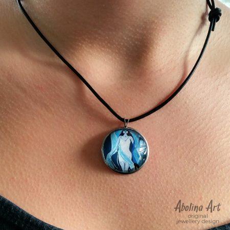 Model wearing Returning art pendant 25mm glass dome strung on black cord