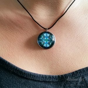 Lumino art pendant worn by model