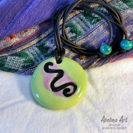 Lime iris snake pendant strung on leather cord