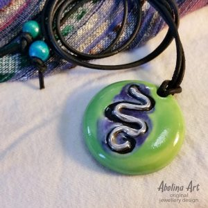 Green stoneware pendant with silver snake