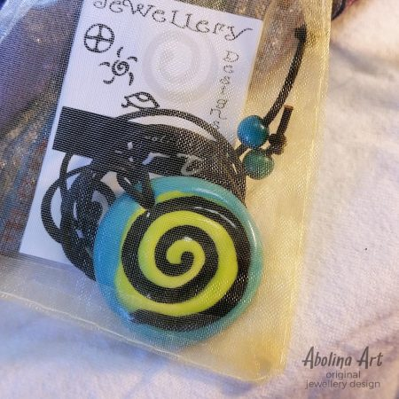 Stoneware pendant with symbol card in gift bag