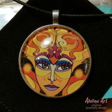 Sun Goddess art pendant on black velvet jewellery pouch