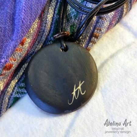 Stoneware pendant back with leather cord