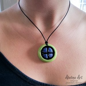 Sun Wheel pendant worn by model