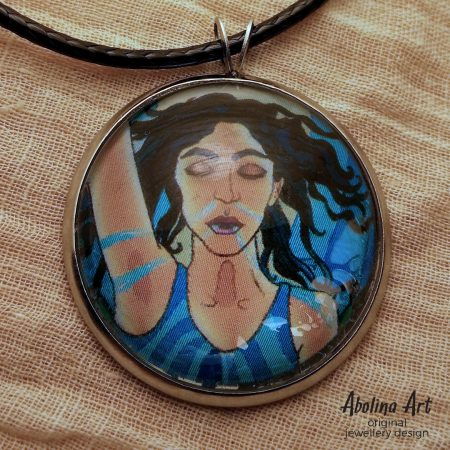Close-up view of Temperance glass dome art pendant