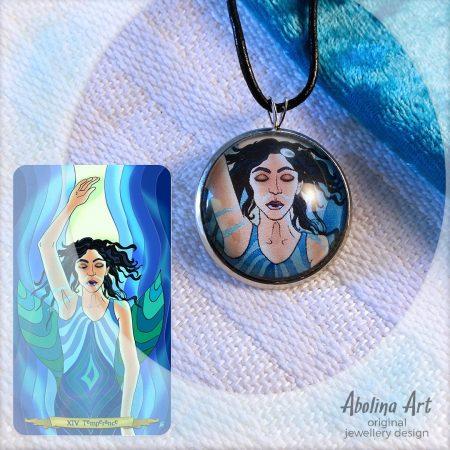 Temperance pendant displayed with tarot card artwork