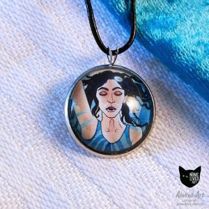 Temperance art pendant on white and turquoise fabric