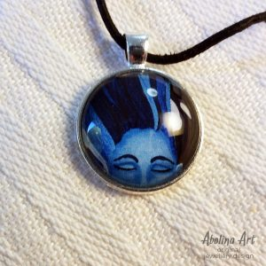 Tranquillity Art pendant on white fabric