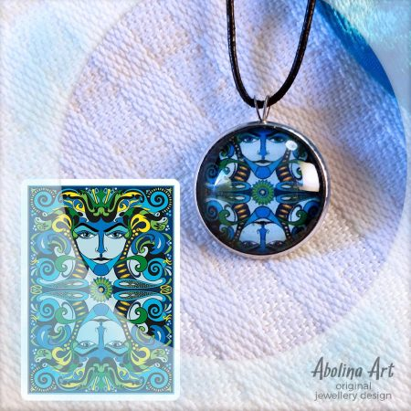 Lumino art pendant displayed with VIZAĜO card back artwork from the blue deck